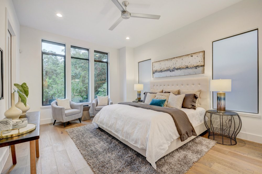 The luxurious main floor master bedroom is a rare offering in the urban 78704 Bouldin neighborhood. This room offers a sitting area creek views, lots of natural light, and access to an outdoor patio.