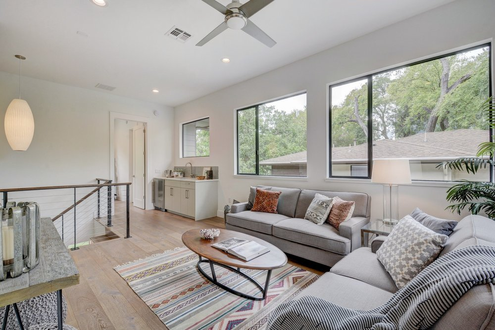 Enjoy downtown Austin view from this Bouldin media room with beverage center wet bar.