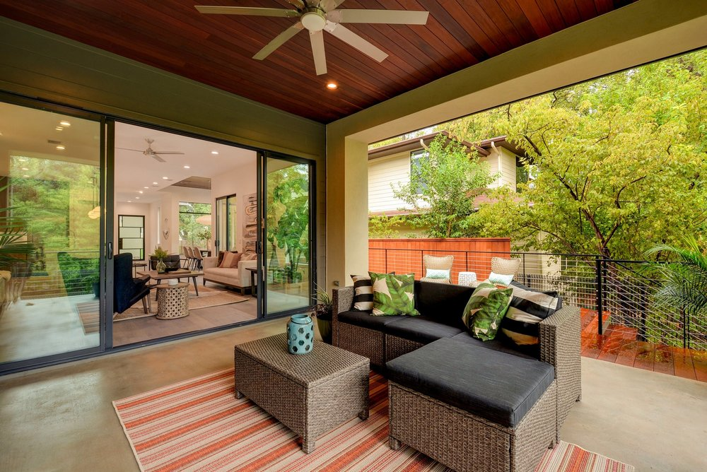 Who wouldn't love this outdoor living area? The ceiling is Ipe, the fan is Minka Aire. This screen porch is perfect to be screened.