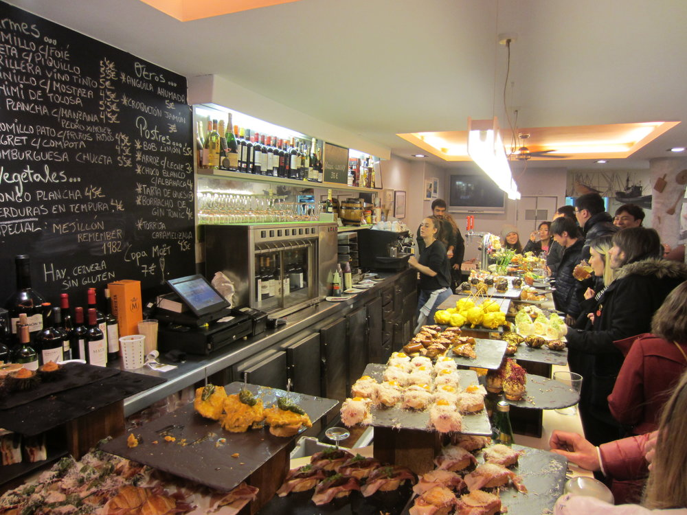 This is an awesome pintxo place called  Bar Zeruko . Notice how the counter is filled with a huge variety of exotic and delicious finger-foods.