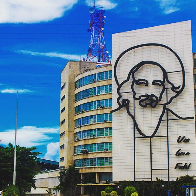 Vas bien, Fidel? Who is this guy who is memorialized seemingly as #Castro's cheerleader? Most Americans don't know who he is but he's revered by #Cubans. Camilo Cienfuegos, the #granma's resident #stonecoldfox and part of the 3 amigos with #Che and Fidel. Here is his facade on the Ministry of Information and Communication in #plazadelarevolucion find out more about him on #NAPerfectWorld.com #travel #Cuba