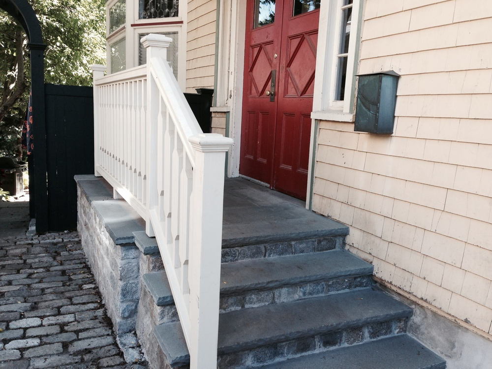 e custom designed and built a railing inspired by theglass pattern in the old window.