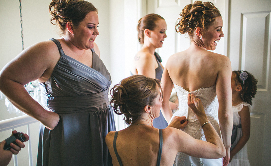 Bridesmaids Helping With the Dress