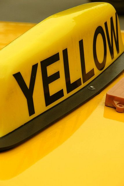 A bright yellow taxi.