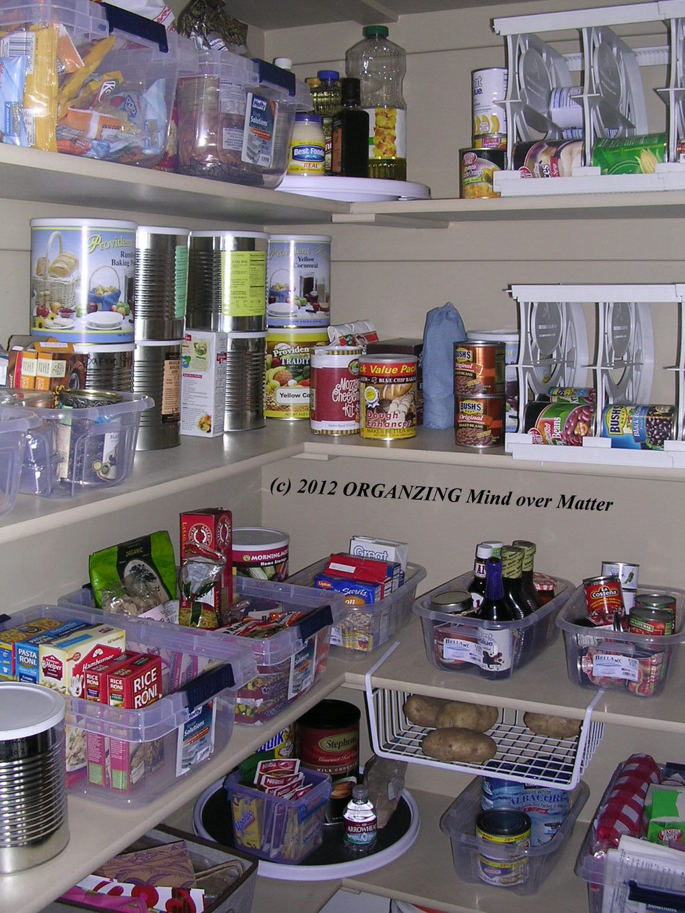 Shown here: Organizing multiple food containers, shapes and sizes. Get the look: plastic storage bins, lazy susan, undershelf basket.
