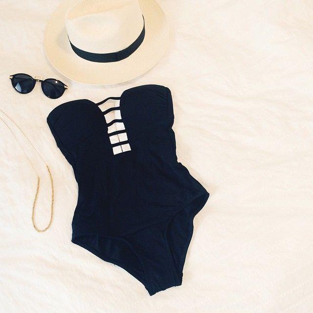 Image courtesy of Kitty Cotten. Jets Bathing Suit; Panama Hat; Sunglasses.