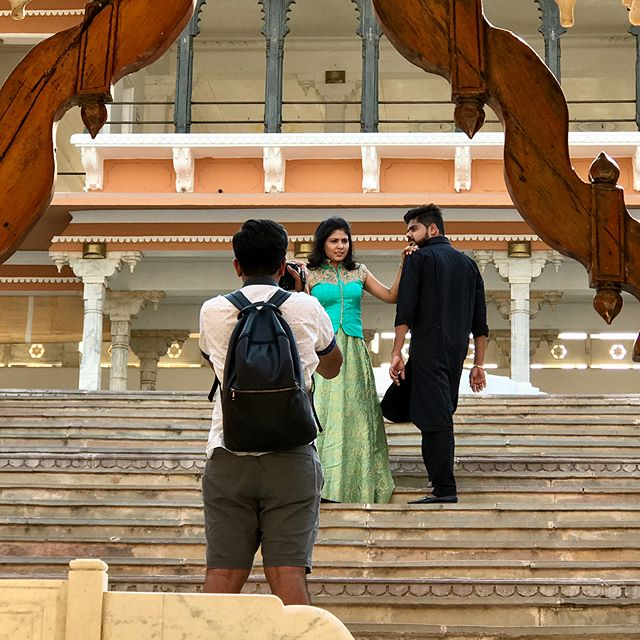 #Behindthescenes from an anniversary portrait shoot in Fateh Garh palace in Udaipur, India - the city of lakes. We shot 7 looks outdoors in a scorching 110 degree weather. It was exhausting. I love bringing a fashion twist to a couples shoot. So much fun! The location was beyond amazing. We could have shot for three days straight without running out of locations and without ever leaving the place. We left at 4am from my home and were there in Udaipur at 8am. It was a little road trip. Our photo permit was for the full day of arrival until 5pm. But they were gracious enough to let us shoot until sunset since I always try not to disturb guests when working at such amazing locations. Minimalism goes a long way and so I defaulted to my one light setup using an #elinchrom strobe I was able to rent that was hooked in to DC power. The palace gave us two huge suites for our base camp and then on top of that, they were generous enough to extend our stay till the next day. Not to mention, complimentary massages after a long day of shooting. We were constantly going up and down the stairs all day. The traditional Rajasthani dinner under the stars was so delicious. Can't wait to go back there again! @fatehgarh @udaipurcity @nikonusa @elinchrom_ltd @elinchromindia @aashna_b_thaker @thakerbhrugu @desaidhrumil @india  #Udaipur #India #Nikon #FatehGarh #photoshoot #palace #travel #couple #couplegoals #love #photography #ootd #fashion #rajasthan