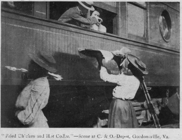 Waiter carriers pass food to passengers on a train stopping in Gordonsville, Va. Image Credits:     NPR    /Town of Gordonsville