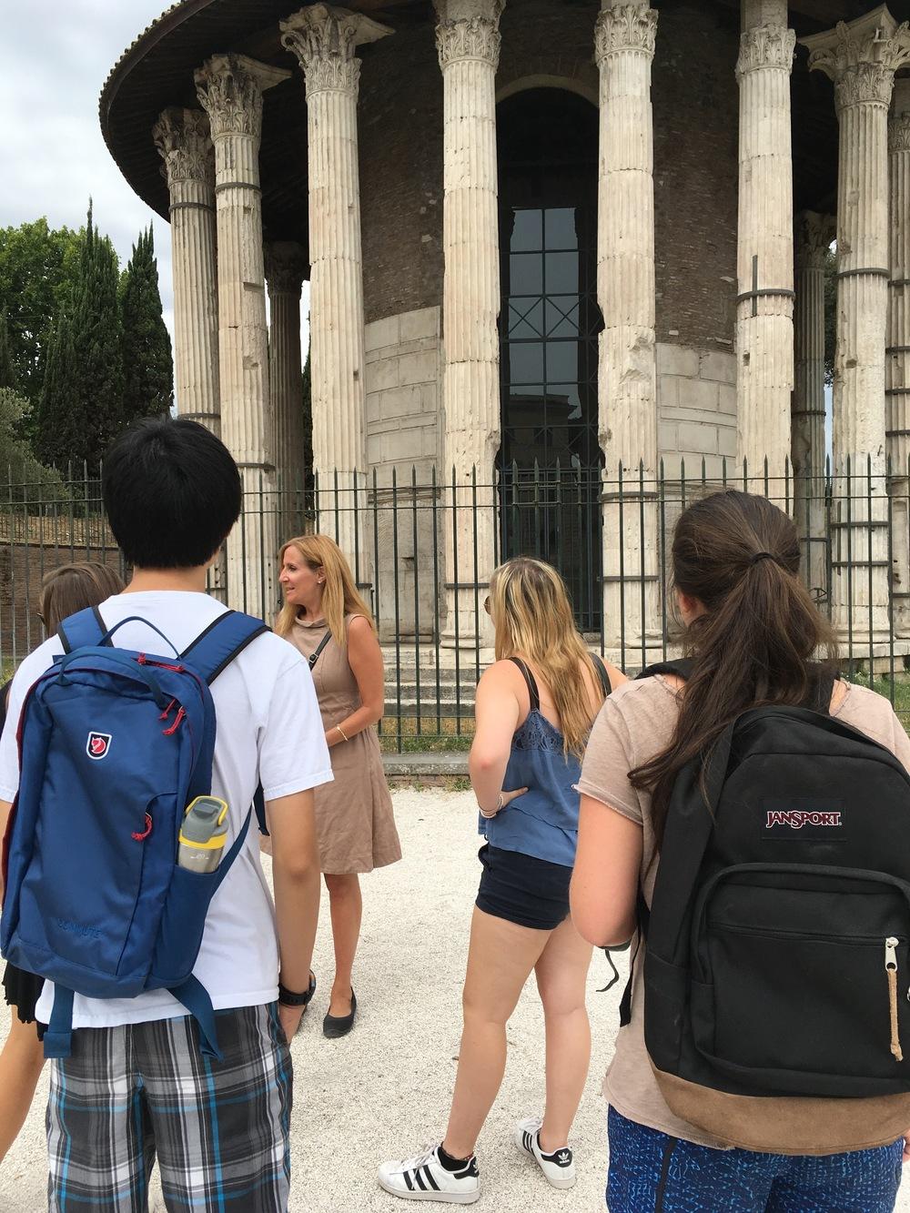 Crispin Corrado standing in front of the Tempio di Ercole Vincitore