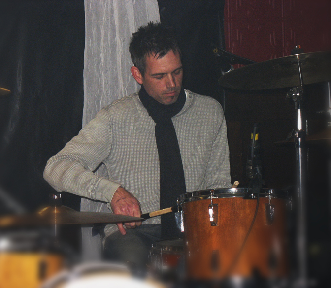Sitting behind the kit with Julian Fist. Questionable scarf choice aside, check out my pinky action.