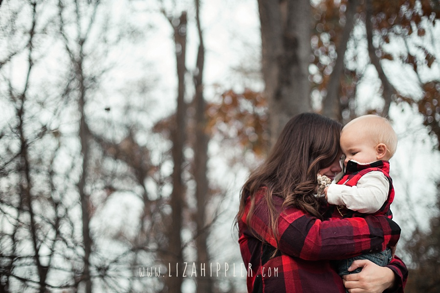 sweet mother and toddler son snuggle moment, mom standing and holding her son