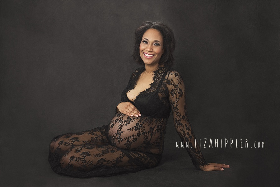 african american maternity portrait black lace dress on black background