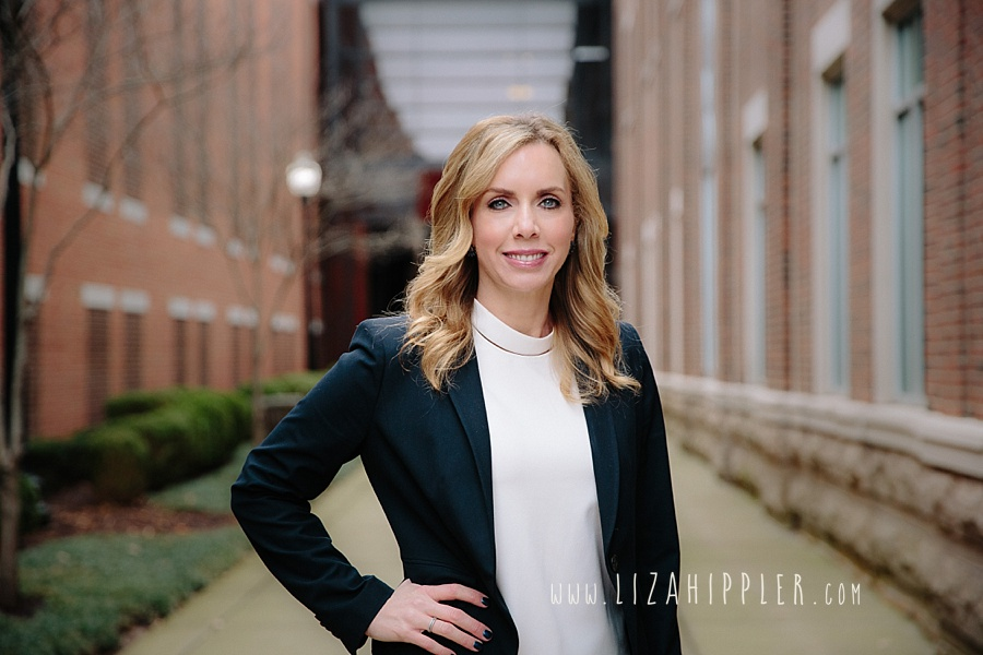 blonde blue-eyed female lawyer stands with hand on her hip in Franklin TN