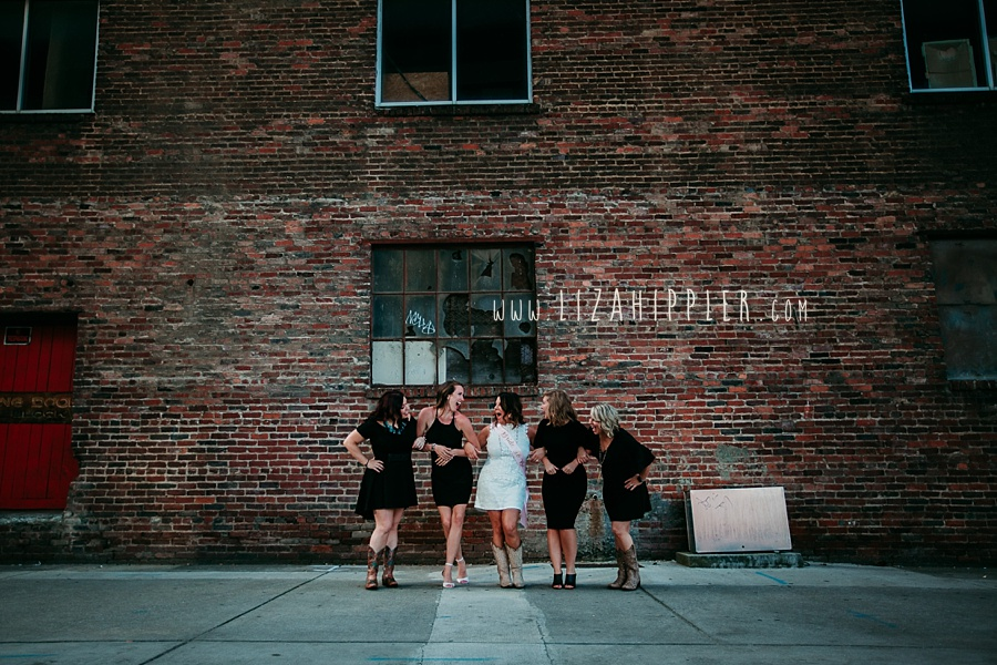 bachelorette party nashville tn five ladies in front of brick wall