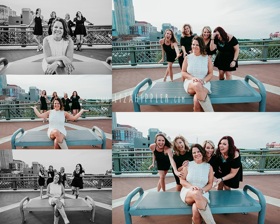 four ladies in black dresses and one in white on Nashville pedestrian bridge for bachelorette