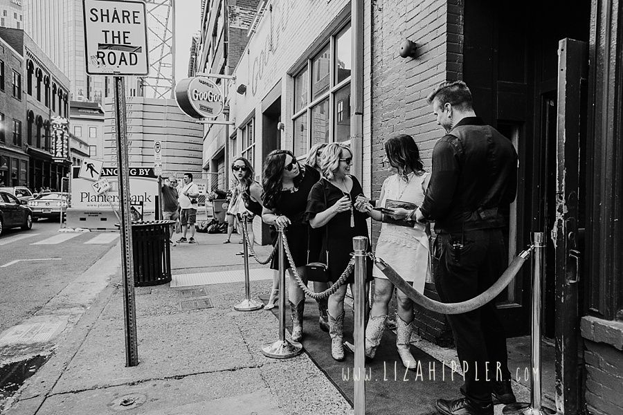 Nashville TN bachelorette party waits on red carpet line to get into a club