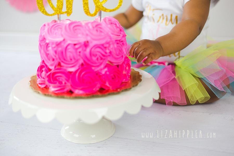 close up of baby girl first birthday cake