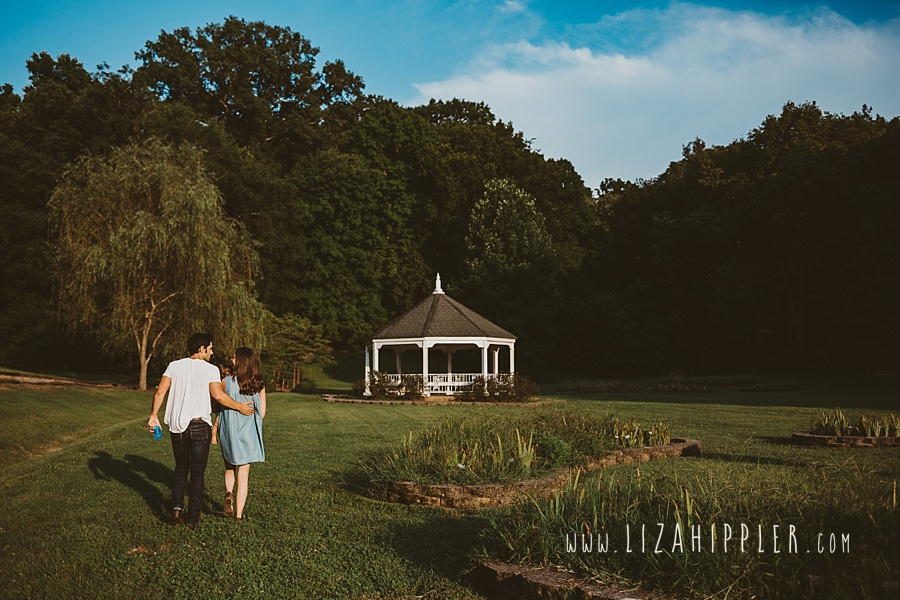 family of three walking toward a gazebo
