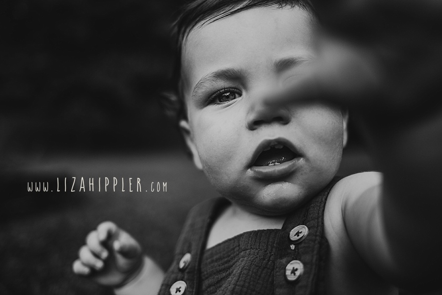 black and white image of chunky cheeks one year old boy
