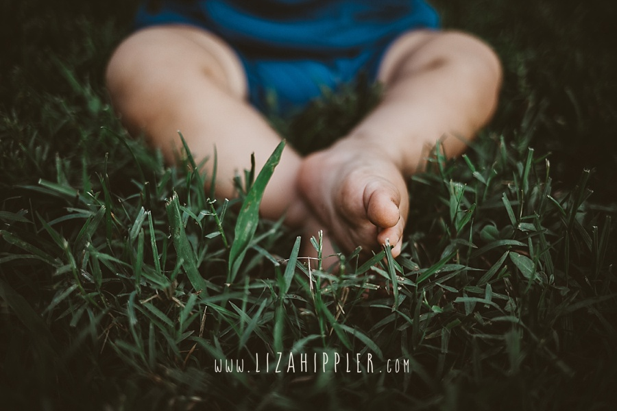 dirty baby feet in grass