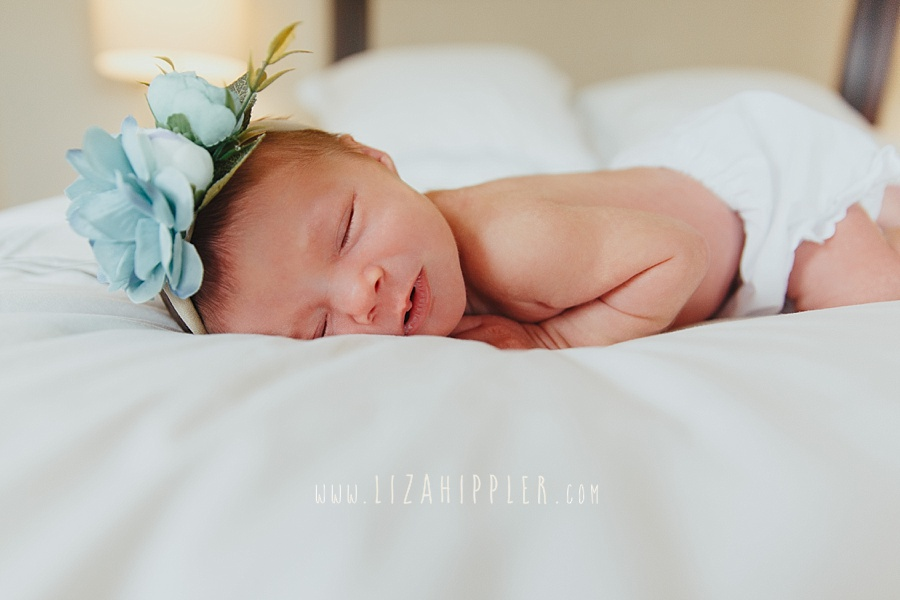 newborn baby girl on bed