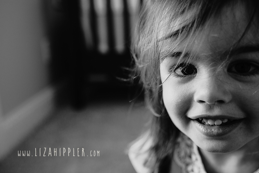 toddler girl close up black and white