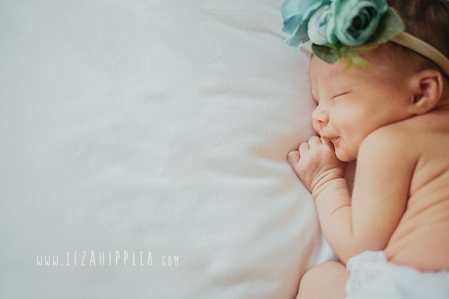newborn kissy face girl