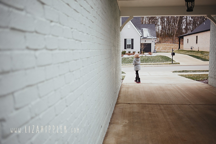 girl walking down driveway