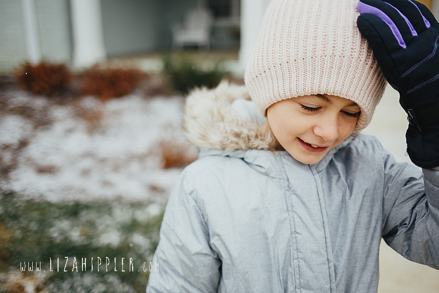close up of 8 year old in pink winter hat