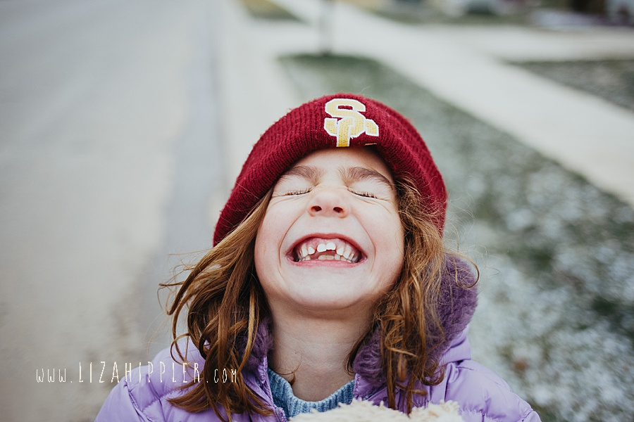 little sister toothy grin with USC hat