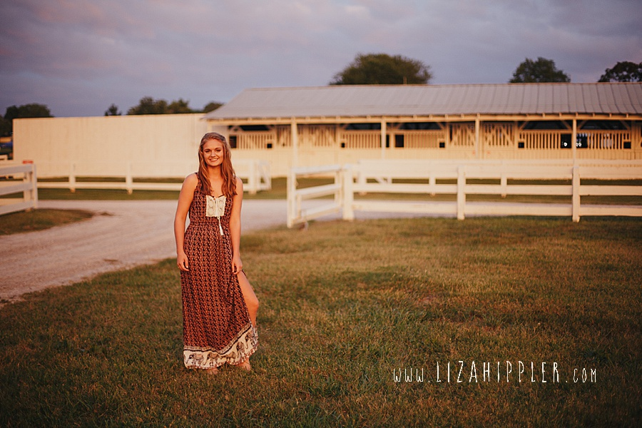 blonde senior in plantation dress poses for senior shoot