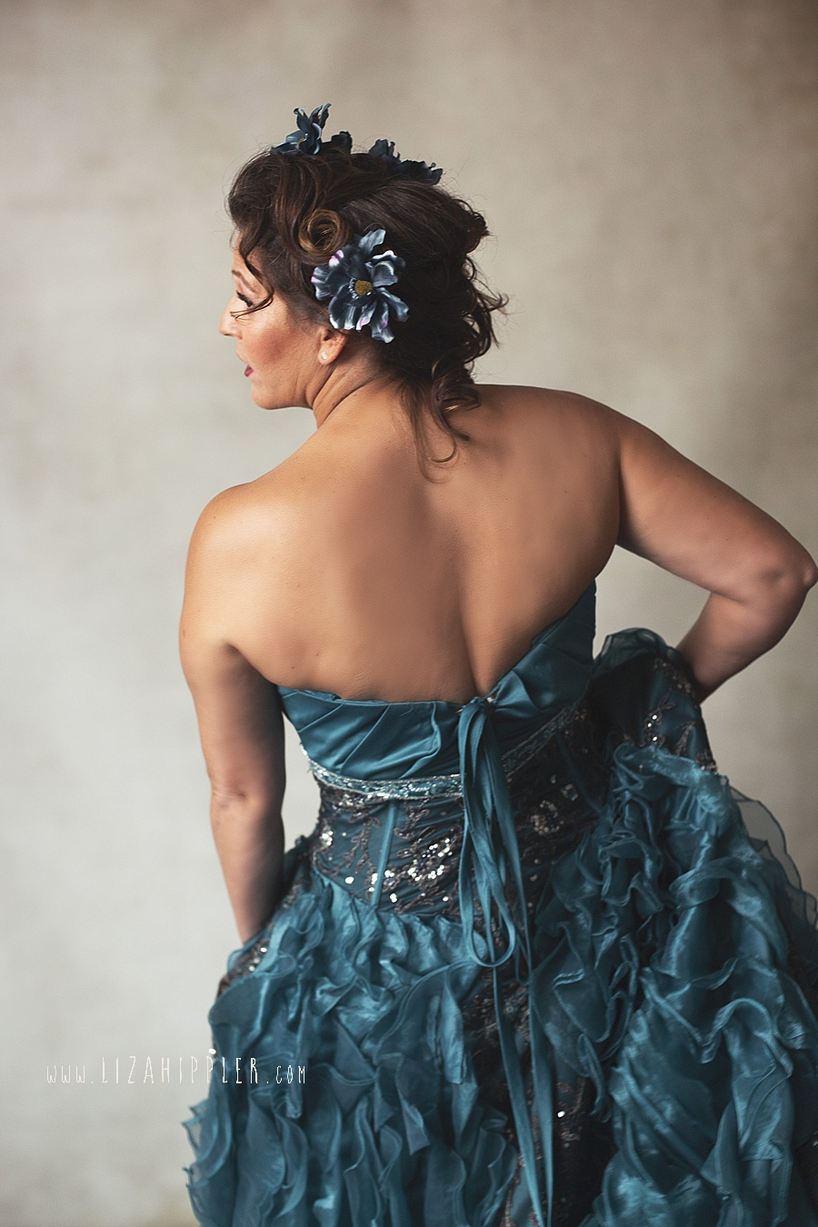 back of woman dancing in layered blue dress
