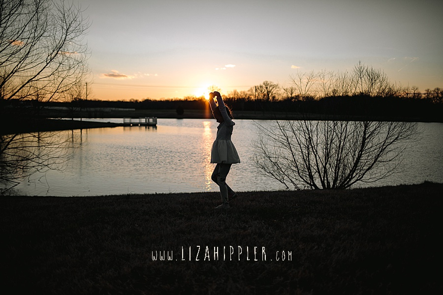 little girl twirls as the sun goes down