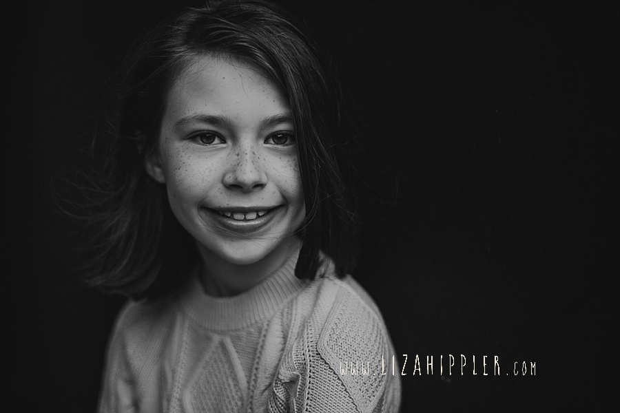 black and white image of 8 year old girl with freckles