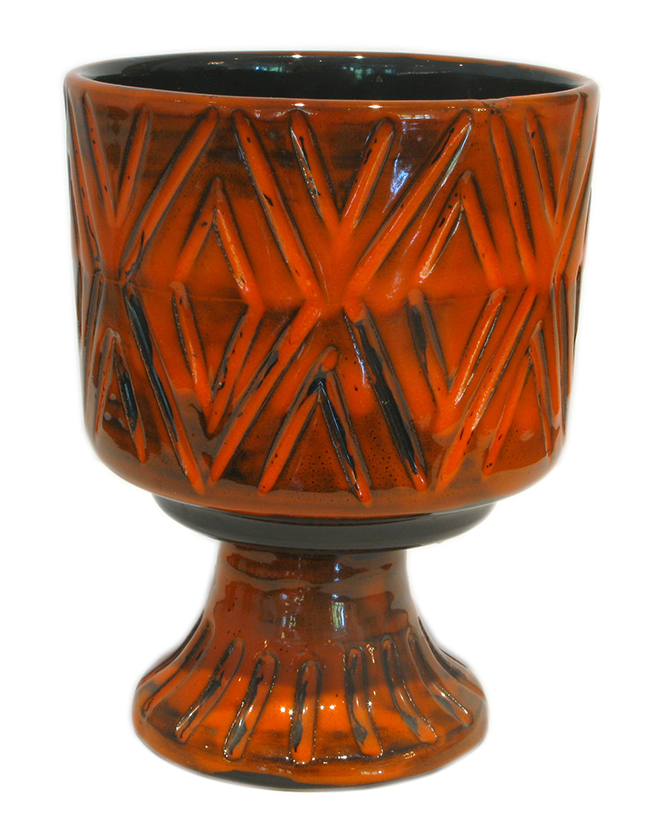 Ceramic vase in orange with pedestal base: $55