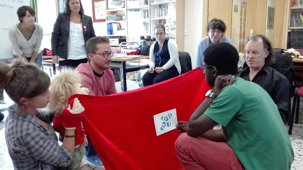 Tommy holding the curtain and students holding the flashcards (pictures are on both sides)