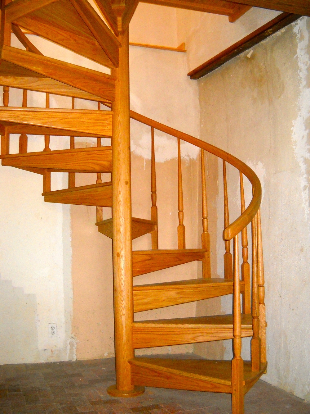 Custom oak spiral stairs.