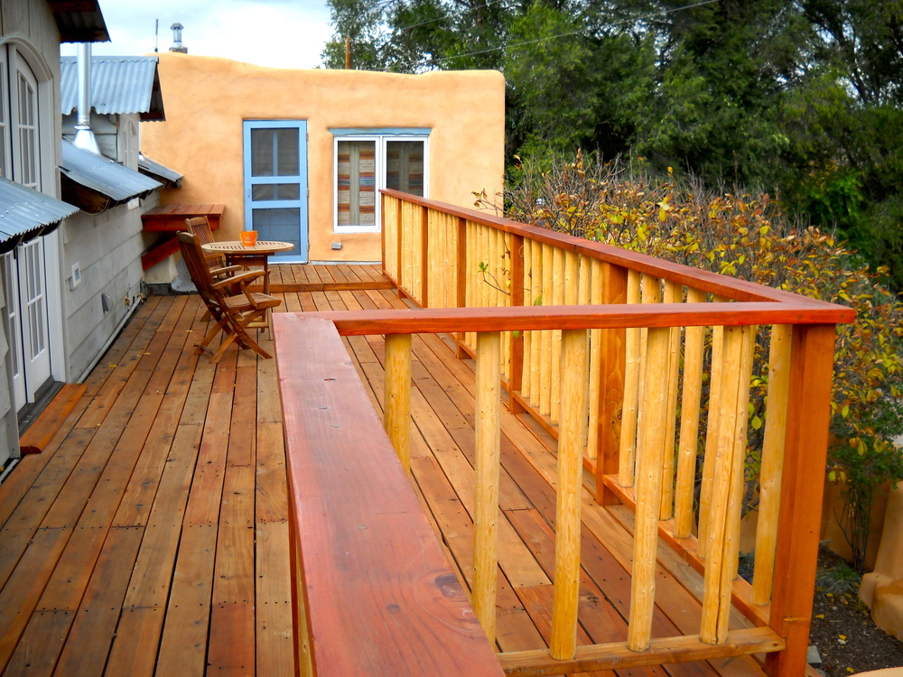 East deck, redwood railing.