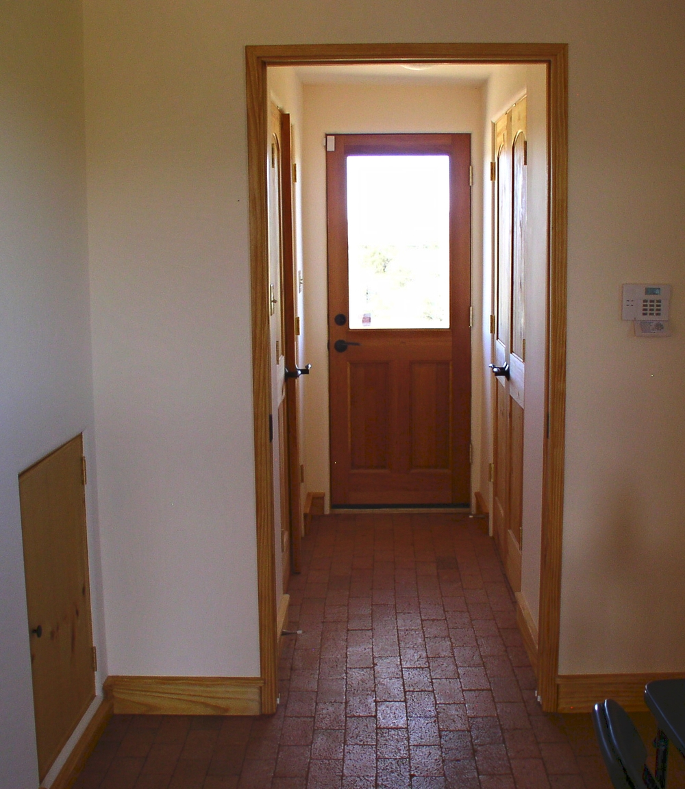 Hallway to half-bath, washer/dryer, and mechanical.