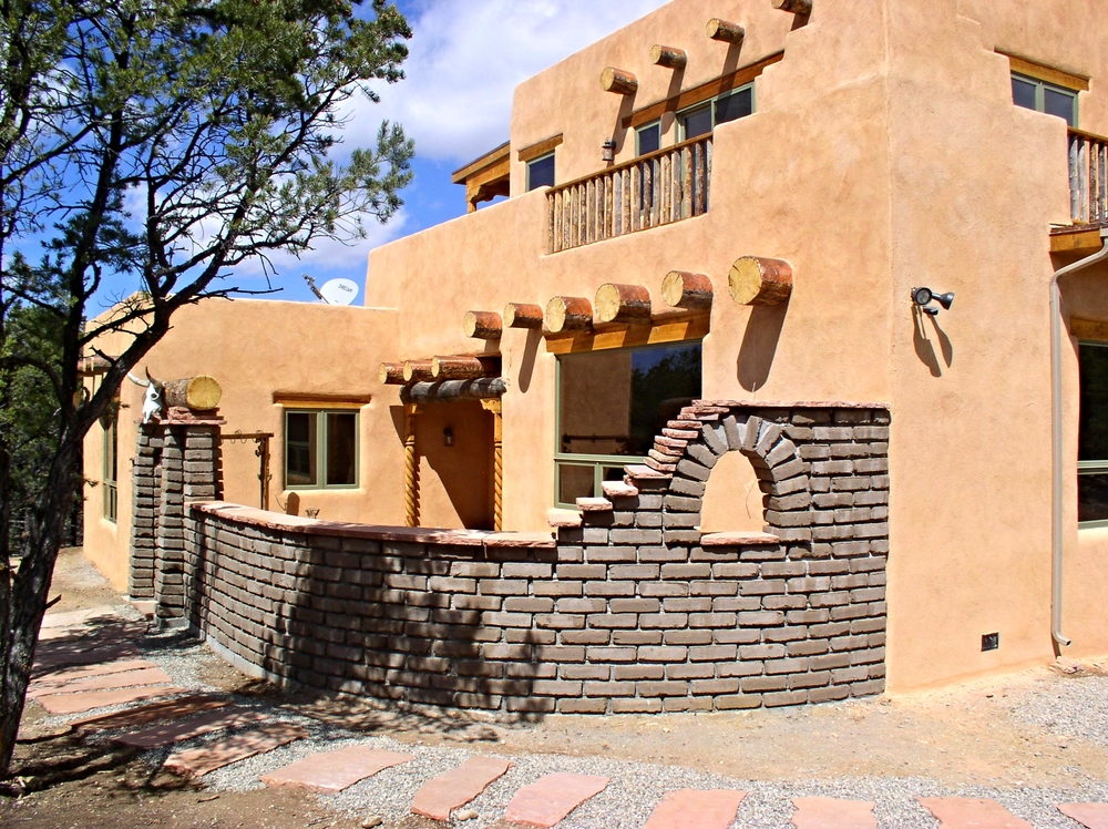 Pueblo-Style Two-Story Adobe   This home uses  RASTRA  wall materials and many other unique features are incorporated in the construction. Designed by  Sunwood Design.