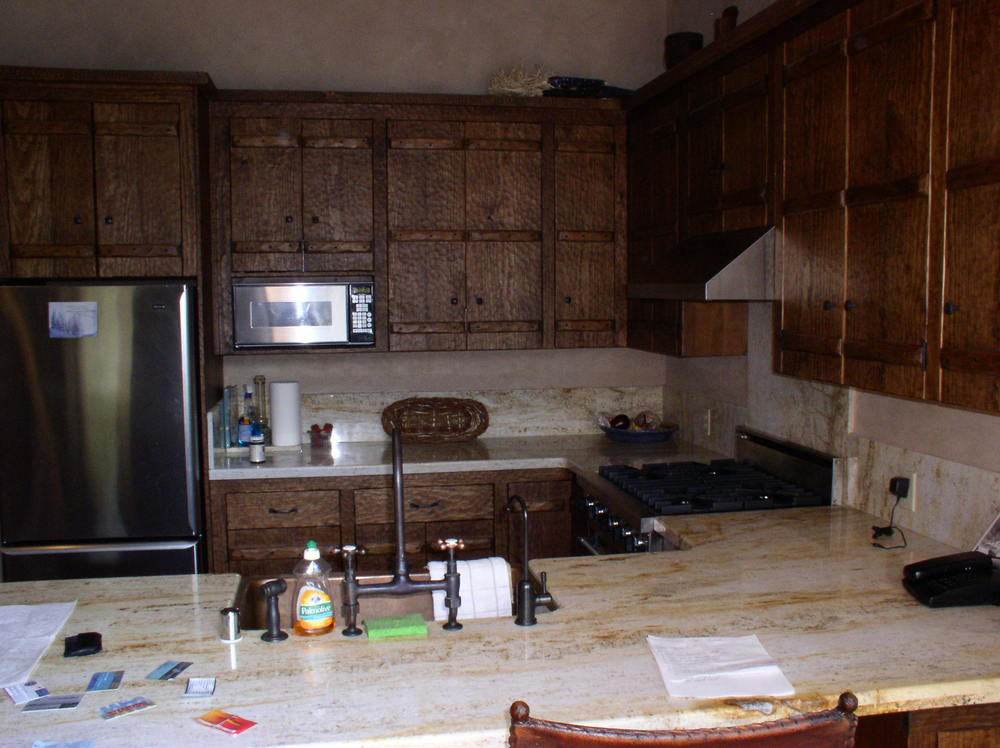 Hand-carved cabinet doors and italian marble in the kitchen.