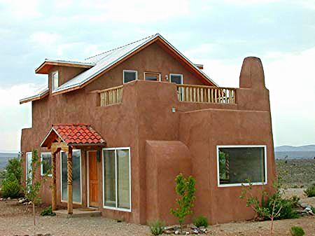 Southwestern Dream Farmhouse   This  post-and-beam  with strawbale home comes with custom pine spiral staircase, stained concrete floors, stone window and door sills, nichos, talavera tile, smooth interior plaster, and much more.