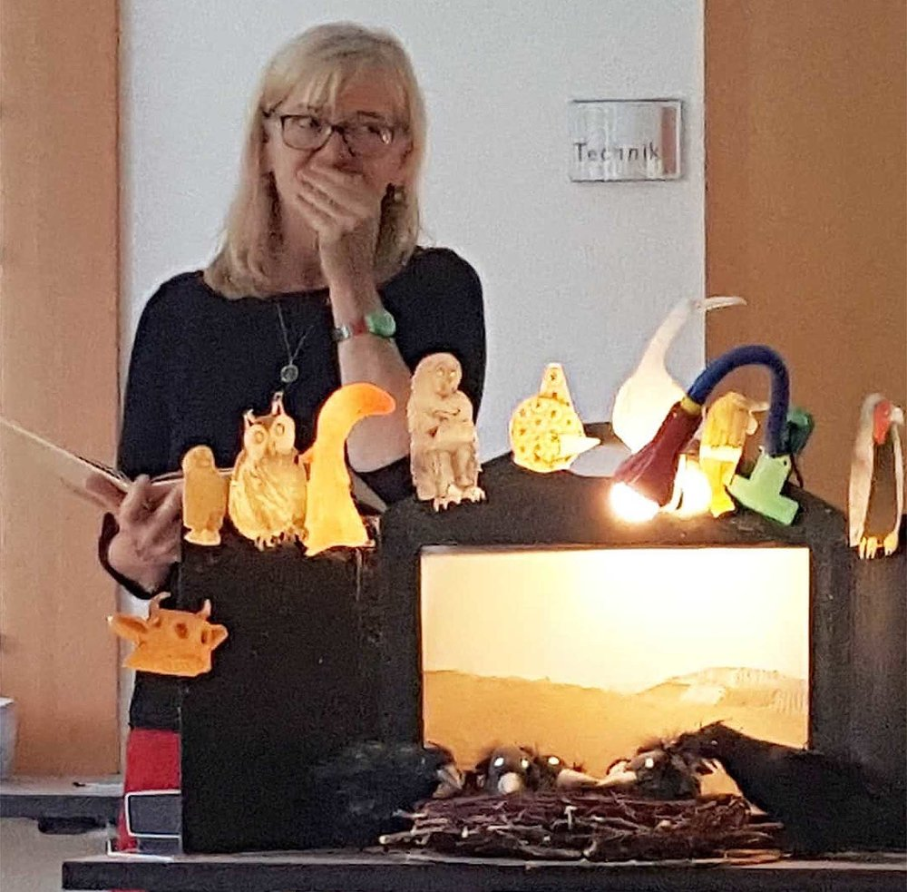 Bansch at a school visit with her raven puppets