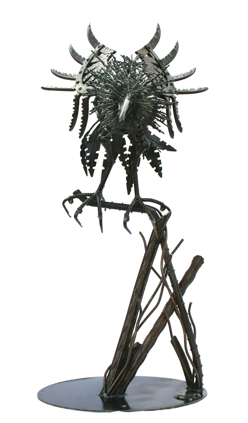 "Harrow bird on branch (36"" tall x 20"" wide x 24"" long)"
