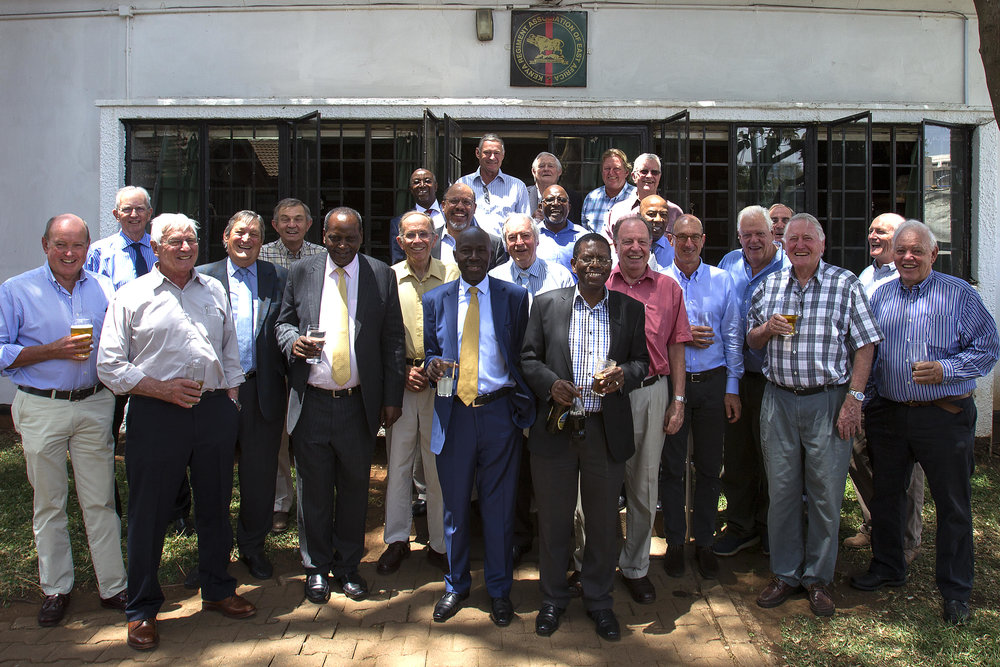 OY Lunch, Nairobi  Front L to R: Henry West, Gaying May, Jeremy Mott, Jonny Havelock, Dave Mousley, Chairman of BoG - SR (Samson) Ndegwa, Peter Paterson, Joe Okwach, Tony Massie Blomfield, Sam Mwaura, Dudley Stannah, Renzo Benardi, John Baxendale, (nearly hidden) Nigel Gaymer, Jock Anderson (went to DoY when in Government House 1949), Ronnie ANdrews, Miki Baxendale  2nd Row L to R: Martin Mogwanja, Johnny Akatsa,Richard Njoba,  Back Row L to R: Peter Gachuhi, Charlie Fraser, Mike Andrews, Jonathan Savage, Al Sinton (Saints)