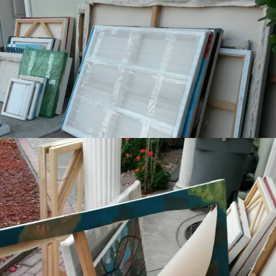 Sorting, packing and taking canvas off the frame to roll up, or, in some cases, throw away.
