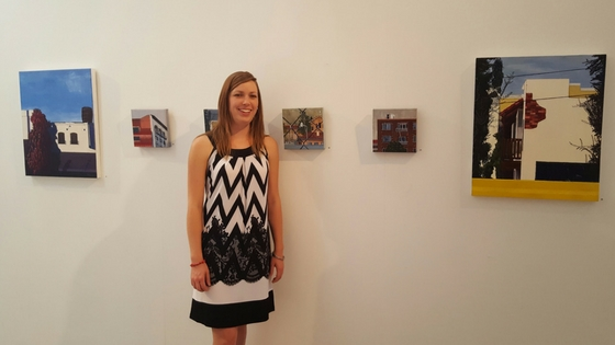 "Christine Rasmussen in front of her paintings at ""Solidarity"" opening reception, Aug. 21, 2016. Photo credit: Eleonor Doctora Villena."
