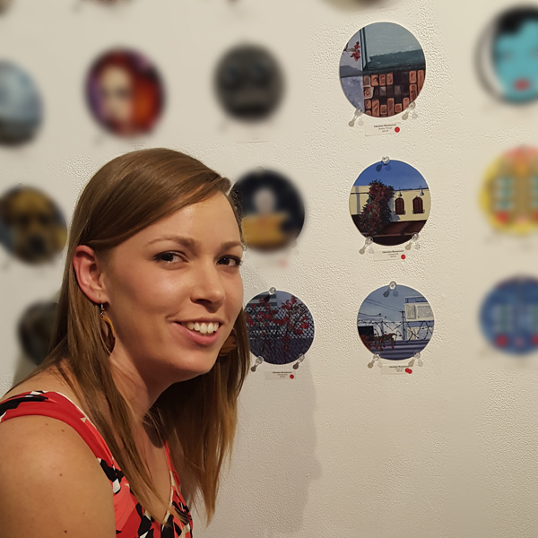 C. Rasmussen in front of her art (with red dots!) at the opening reception for the 4th Annual Coaster Show at La Luz de Jesus Gallery, Sept. 2, 2016.