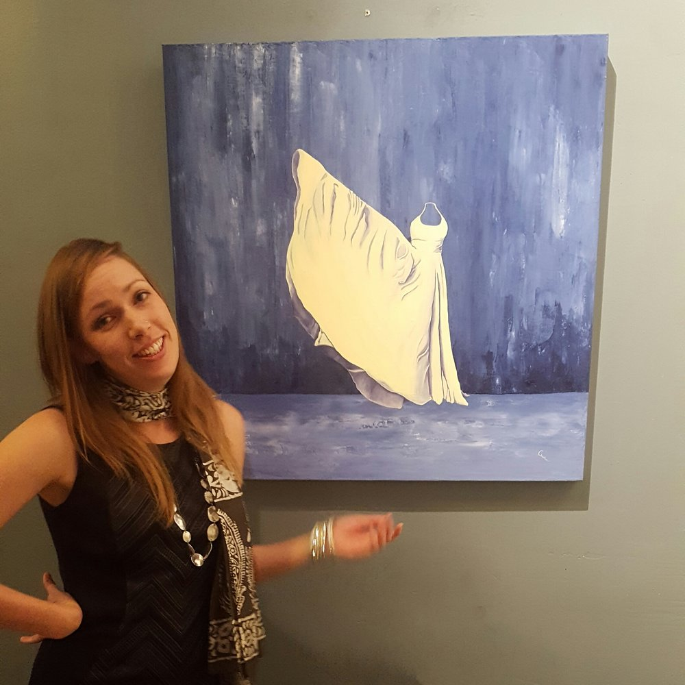 "Christine Rasmussen in front of her painting, ""Phenomenal Woman"""