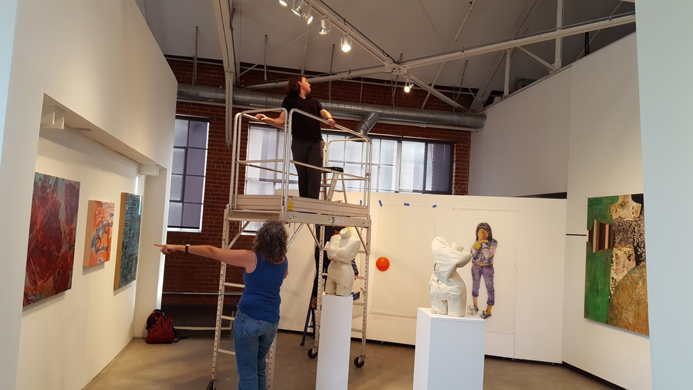Adjusting the lights. Pictured: Jeanie Frias & David Goetz (on scaffolding). | Photo credit: C. Rasmussen.